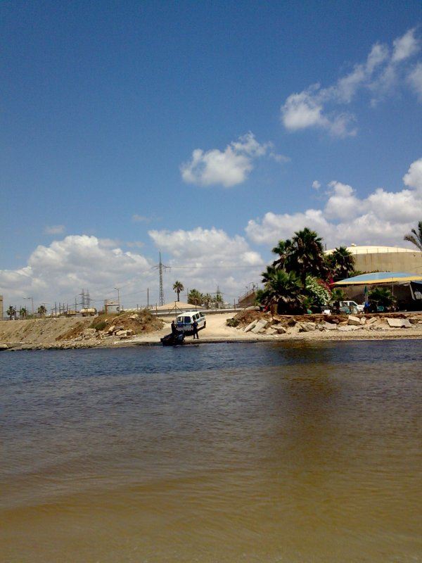 Israeli policemen illegally dumping waste into the Yarkon River near the Reading Power Station