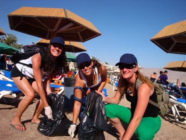 Zalul's two internists and friend during beach clean-up