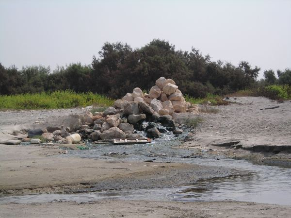 Pollution from a industrial pipeline flows onto the beach near Haifa.