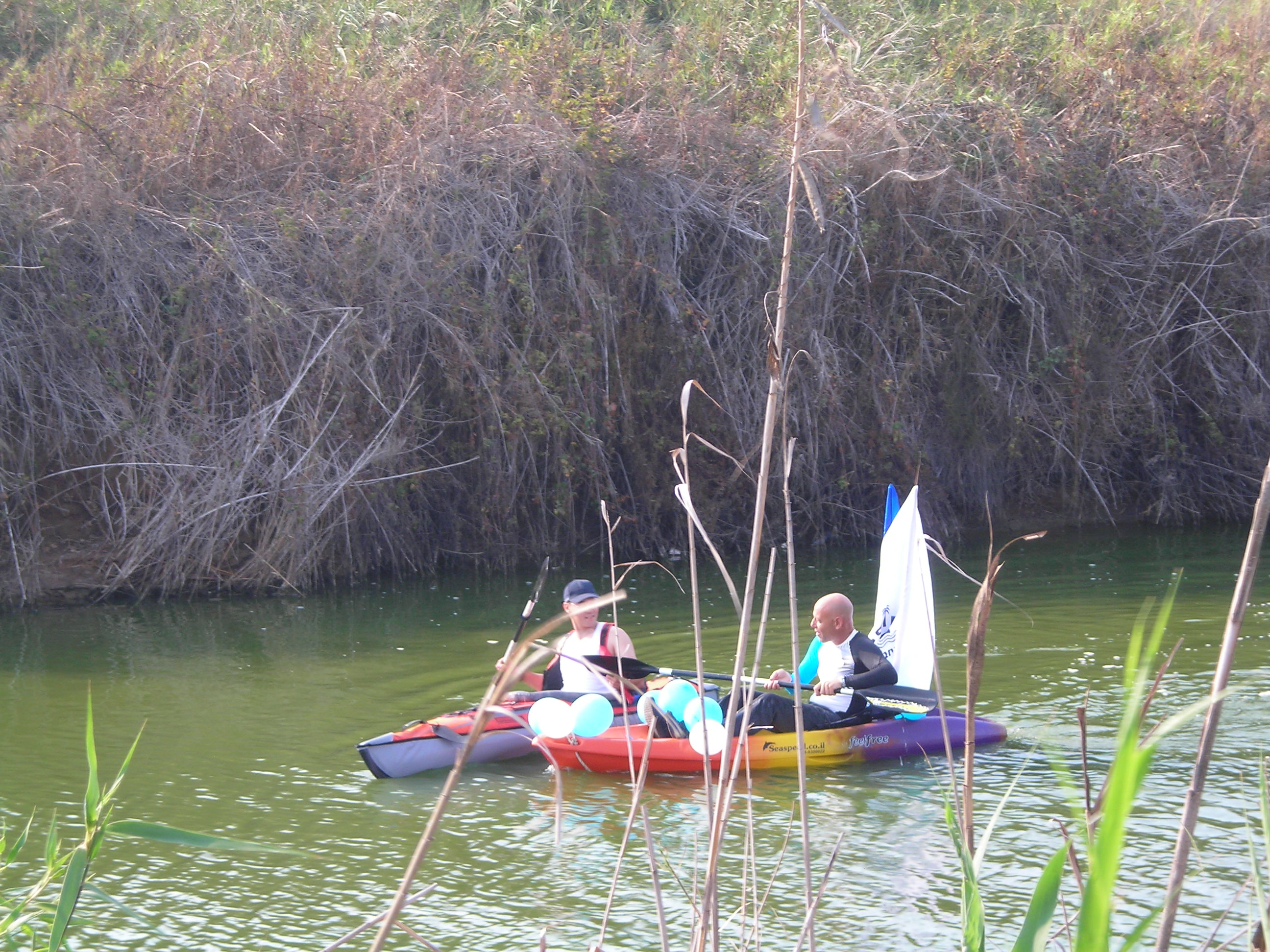Zalul's Assistant Director, Ezer Fischler (L), kayaks in the Lachish River for the first time in decades with Adi Ben-Lish, Director of Park Lachish in Ashdod.