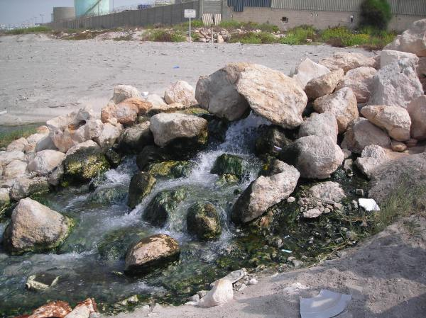 Wastewater being discharged onto a beach in Northern Israel.