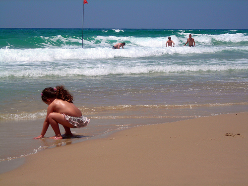 Some beach lovers enjoy a beautiful day in the Mediterranean.